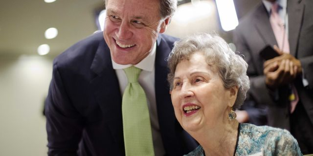 Georgia Republican Sen. David Perdue, left, has emerged as a close Trump ally.