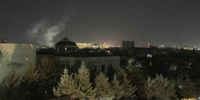 A plume of smoke rises near the U.S. Embassy in Kabul, Afghanistan on Wednesday, Sept. 11, 2019. A blast was heard shortly after midnight on the anniversary of the 9/11 attacks. (AP Photo/Cara Anna)