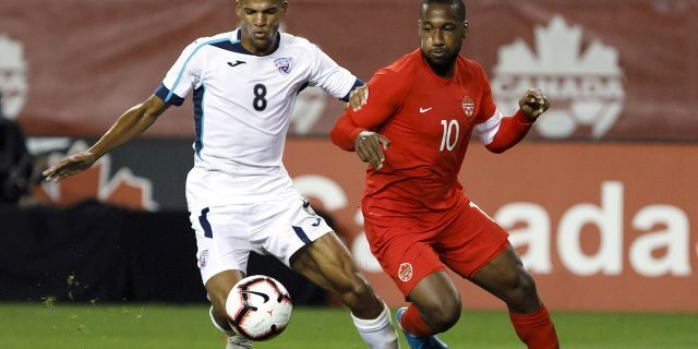 Canada forward Junior Hoilett (10) and Cuba midfielder Alejandro Portal (8) battle for the ball during the second half of a CONCACAF Nations League soccer match in Toronto, Saturday, Sept. 7, 2019. (Cole Burston/The Canadian Press via AP)
