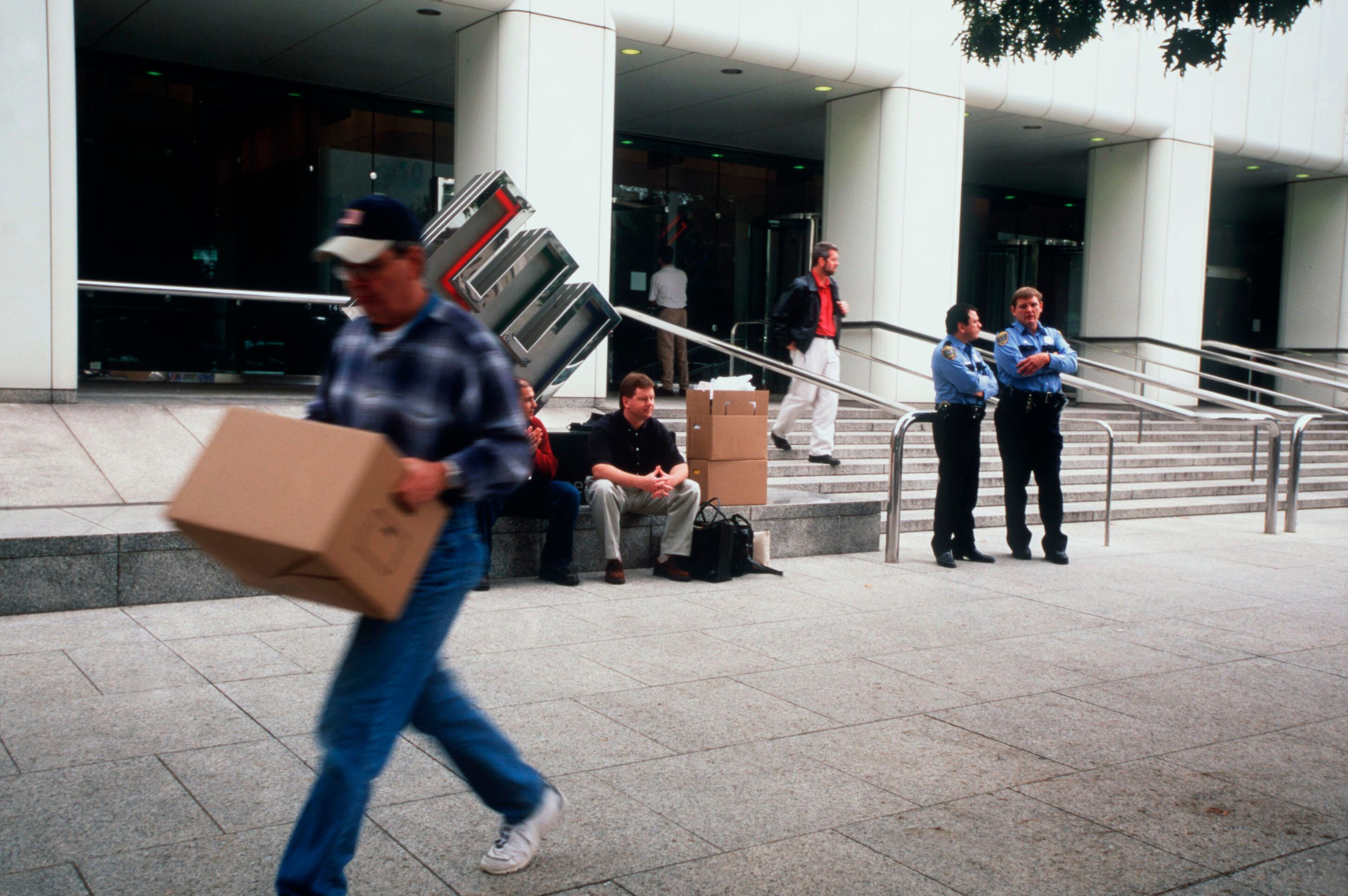 Employees remove their belongings from Enron's corporate headquarters after being laid off due to the company's collapse.