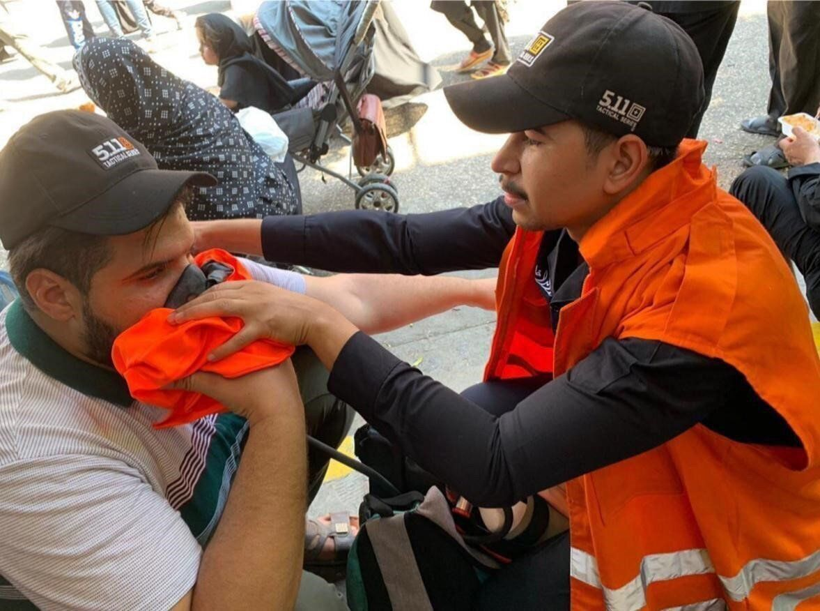 KARBALA, IRAQ - SEPTEMBER 10: People, affected from the stampede, receives medical attention from Iraqi health team, on Septe