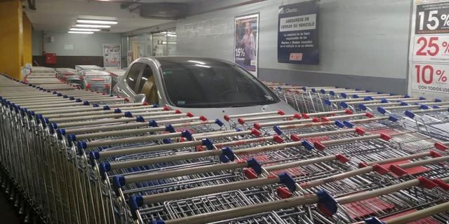 A grey Peugeot 308 parked incorrectly at an Argentina supermarket was closed off by shopping carts.