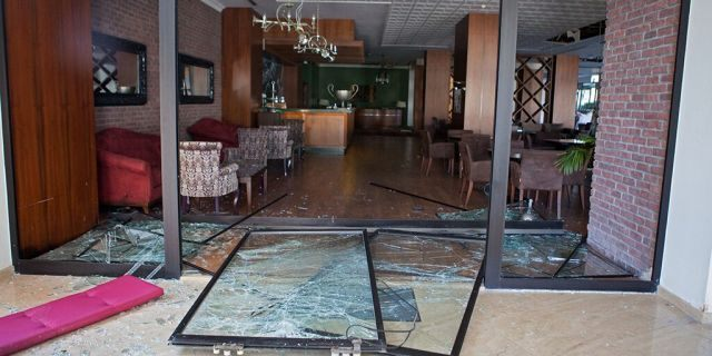 Sept. 12, 2019: Shattered glass doors at the Acapulco hotel in Kyrenia (Girne) in the self-proclaimed Turkish Republic of Northern Cyprus (TRNC) north of the divided Cypriot capital Nicosia, after the building was damaged when a military depot exploded nearby. -
