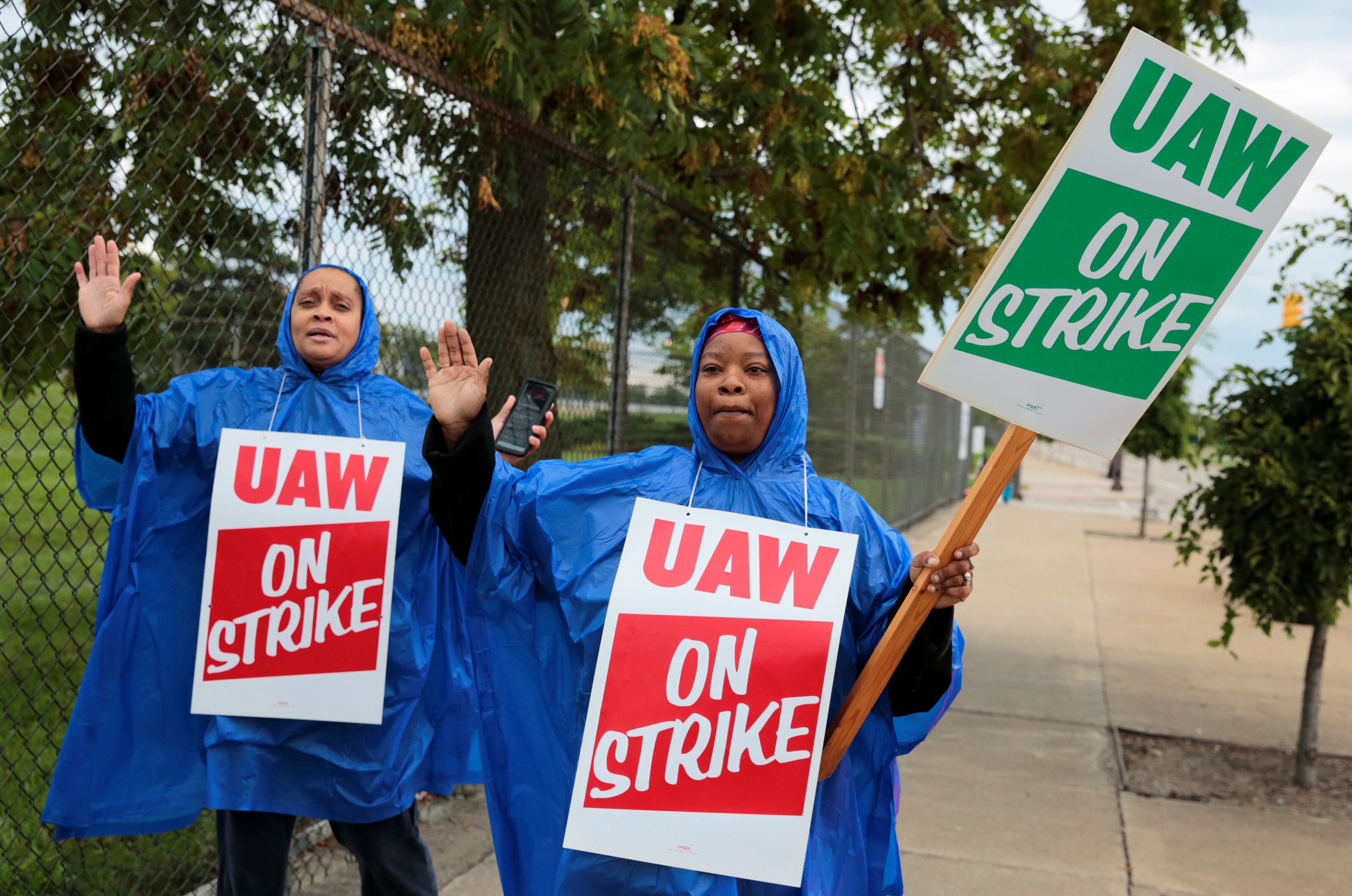 United Auto Workers, Aramark workers, carry strike signs outside the General Motors Detroit-Hamtramck assembly plant in Detro