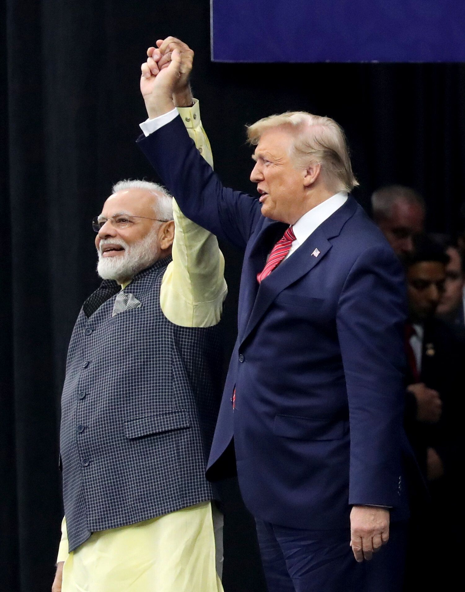 """Trump, who called the gathering a """"profoundly historic event,"""" was greeted with a standing ovation by the Indian-"""