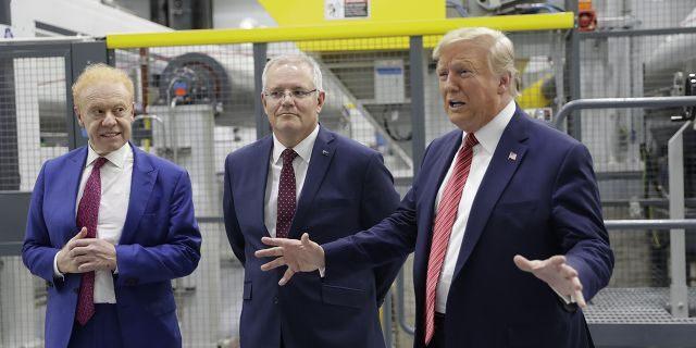 President Trump speaking as Australian Prime Minister Scott Morrison, center, and Pratt Industries chairman Anthony Pratt watched during a factory tour Sunday.