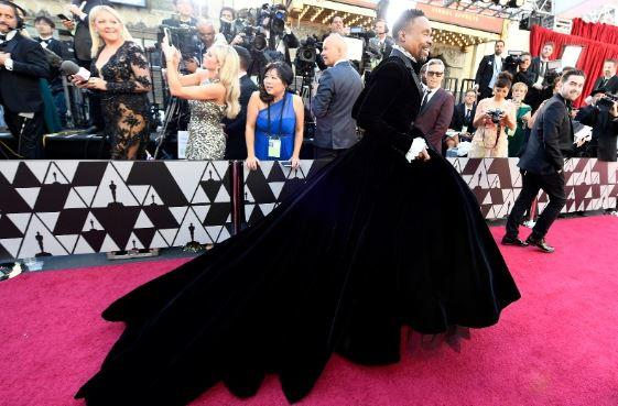 Oscars fashion: Billy Porter defies tradition and steps out onto the red carpet in a gown by designer Christian Siriano