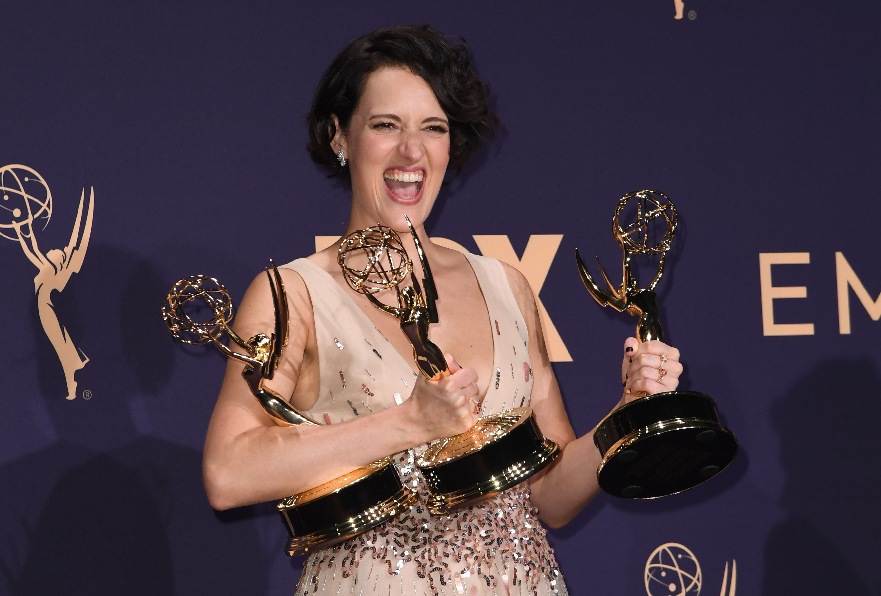 Phoebe Waller-Bridge poses with the Emmy for Outstanding Writing for a Comedy Series, Outstanding Lead Actress In A Comedy Se