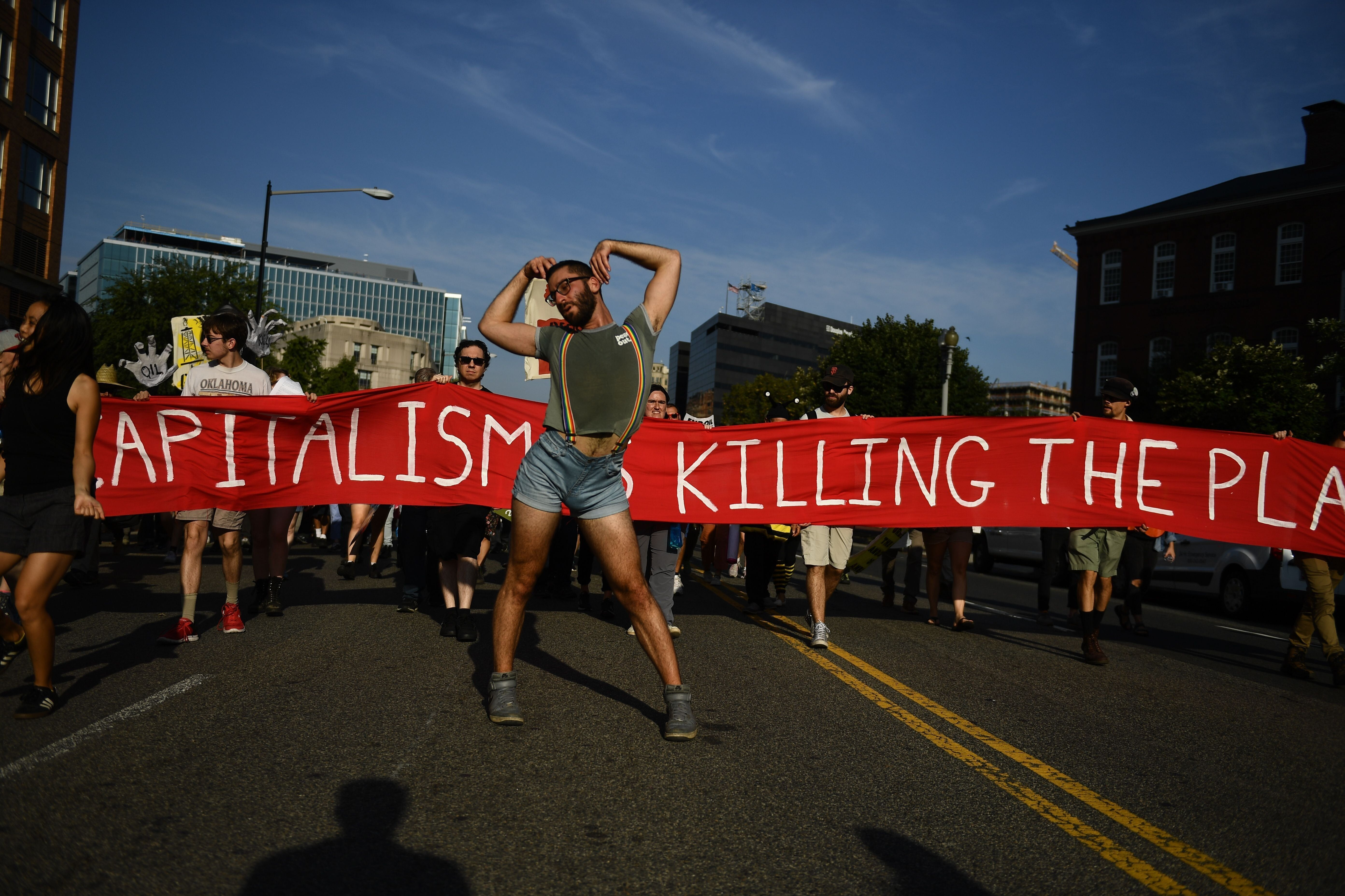 Environmental activists gather in Washington on Monday during global climate action week.