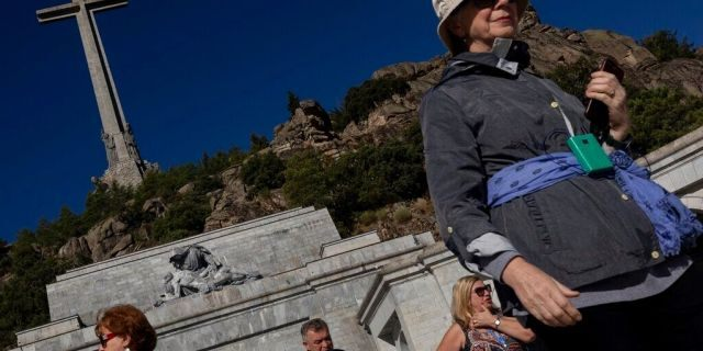Tourists visit the Valley of the Fallen mausoleum near El Escorial, outskirts of Madrid, Spain, Tuesday, Sept. 24, 2019.