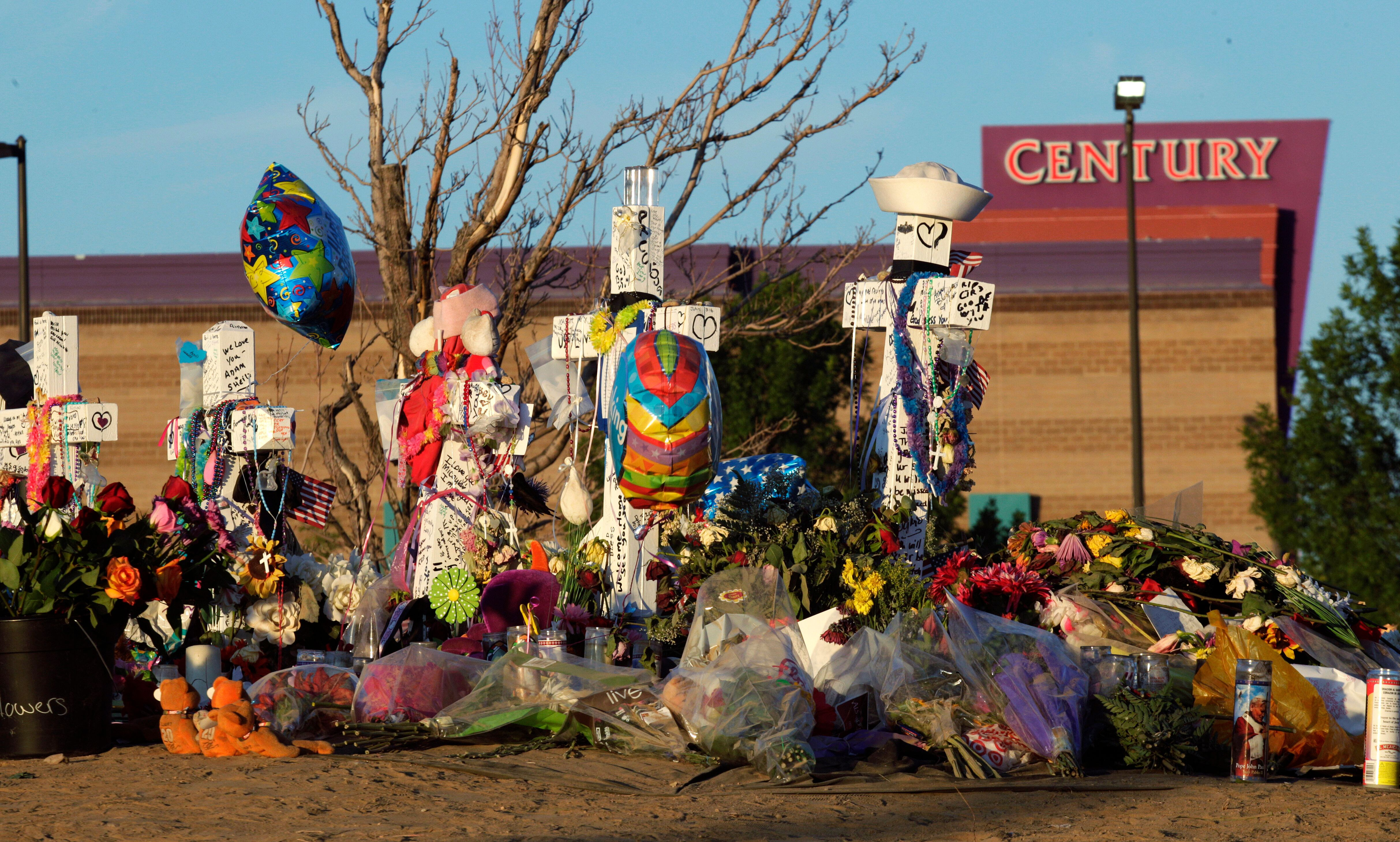In this July 27, 2012, file photo, crosses honor of the victims of the Aurora, Colorado, movie theater shooting. The gunman w