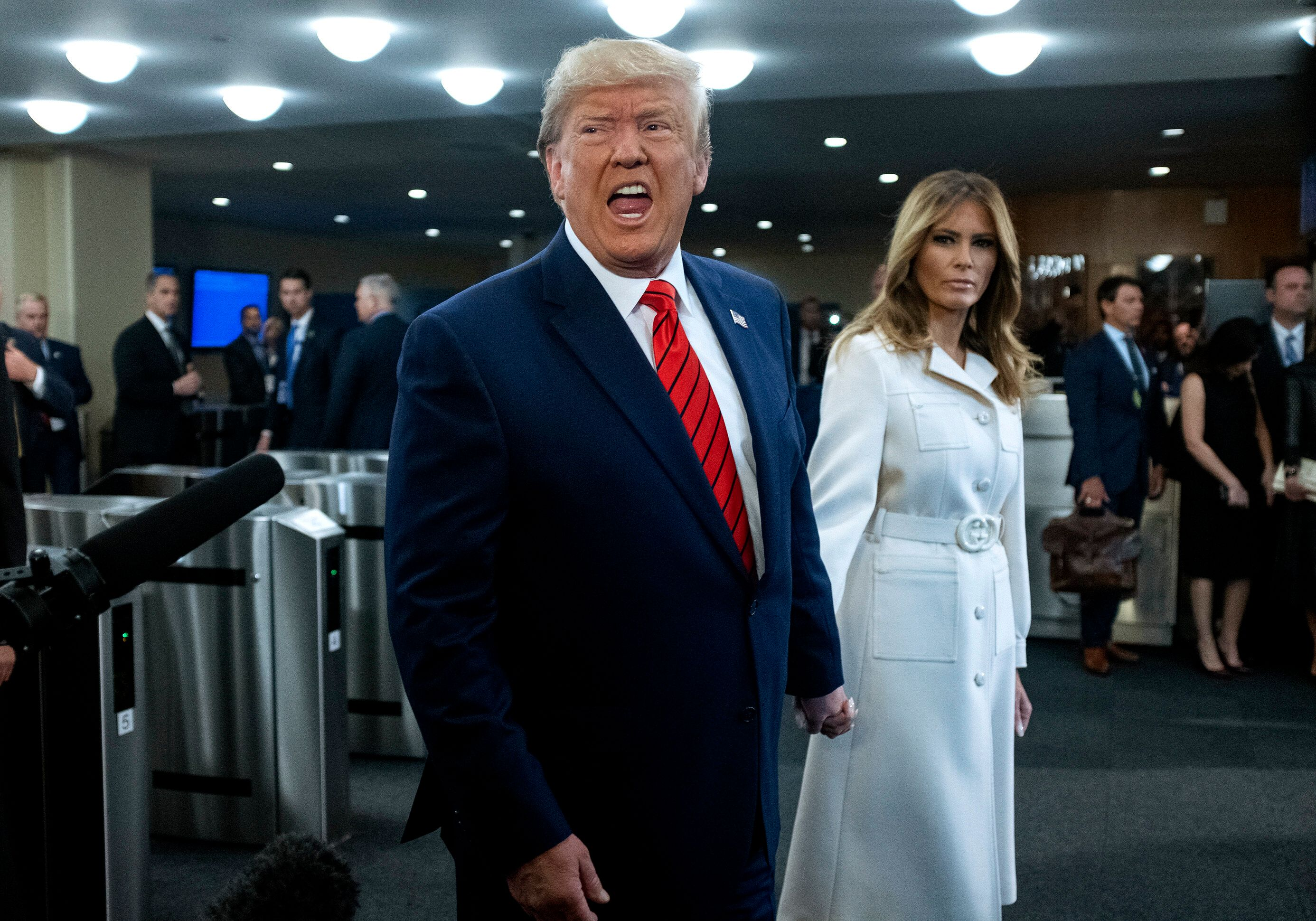 U.S. President Donald Trump addresses reporters as he arrives with first lady Melania Trump for the 74th session of the Unite
