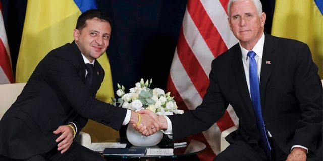 Ukraine's President Volodymyr Zelenskiy, left, shakes hands with U.S. Vice President Mike Pence, in Warsaw, Poland, Sunday, Sept. 1, 2019. (AP Photo/Petr David Josek)