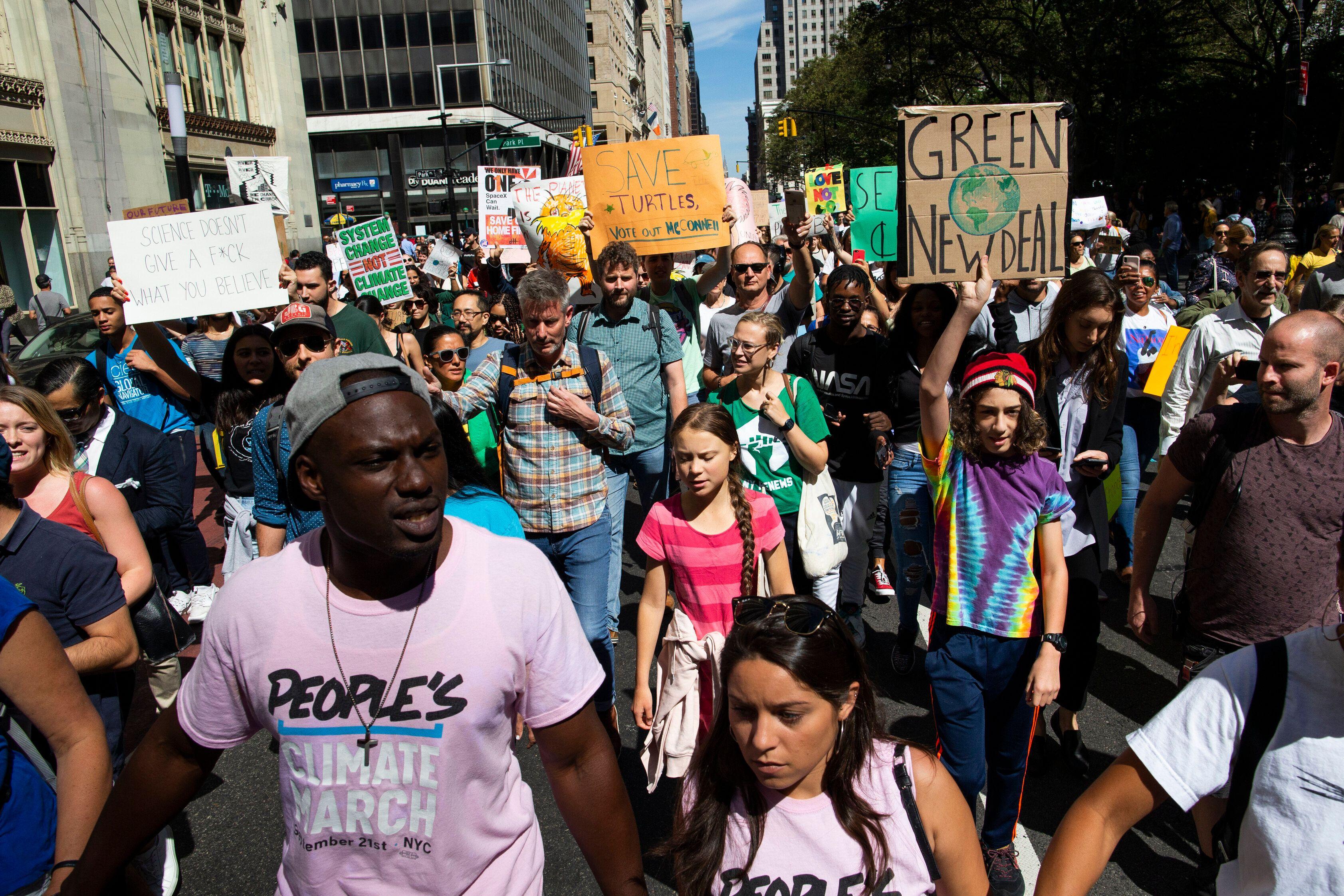 Swedish environmental activist Greta Thunberg, center, takes part during the Climate Strike, on Sept. 20, 2019 in New York.&n
