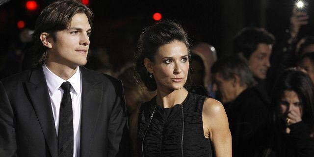 """Cast member Ashton Kutcher and his wife actress Demi Moore attend the premiere of """"No Strings Attached"""" at the Regency Village theatre in Los Angeles January 11, 2011. The movie opens in the U.S. on January 21. REUTERS/Mario Anzuoni (UNITED STATES - Tags: ENTERTAINMENT) - RTXWGKZ"""