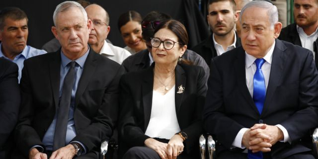In this Thursday, Sept. 19, 2019 file photo, Blue and White party leader Benny Gantz, left, Esther Hayut, the Chief Justice of the Supreme Court of Israel, and Prime Minister Benjamin Netanyahu attend a memorial service for former President Shimon Peres in Jerusalem