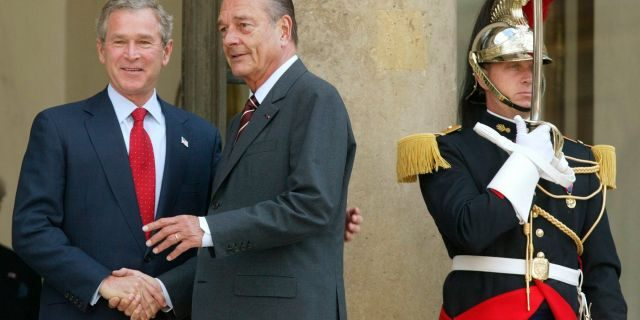 In this June 5, 2004 file photo, President Bush meets with French President Jacques Chirac as a French honor guard member stands guard at the Elysee Palace in Paris. (AP Photo/Charles Dharapak, File)