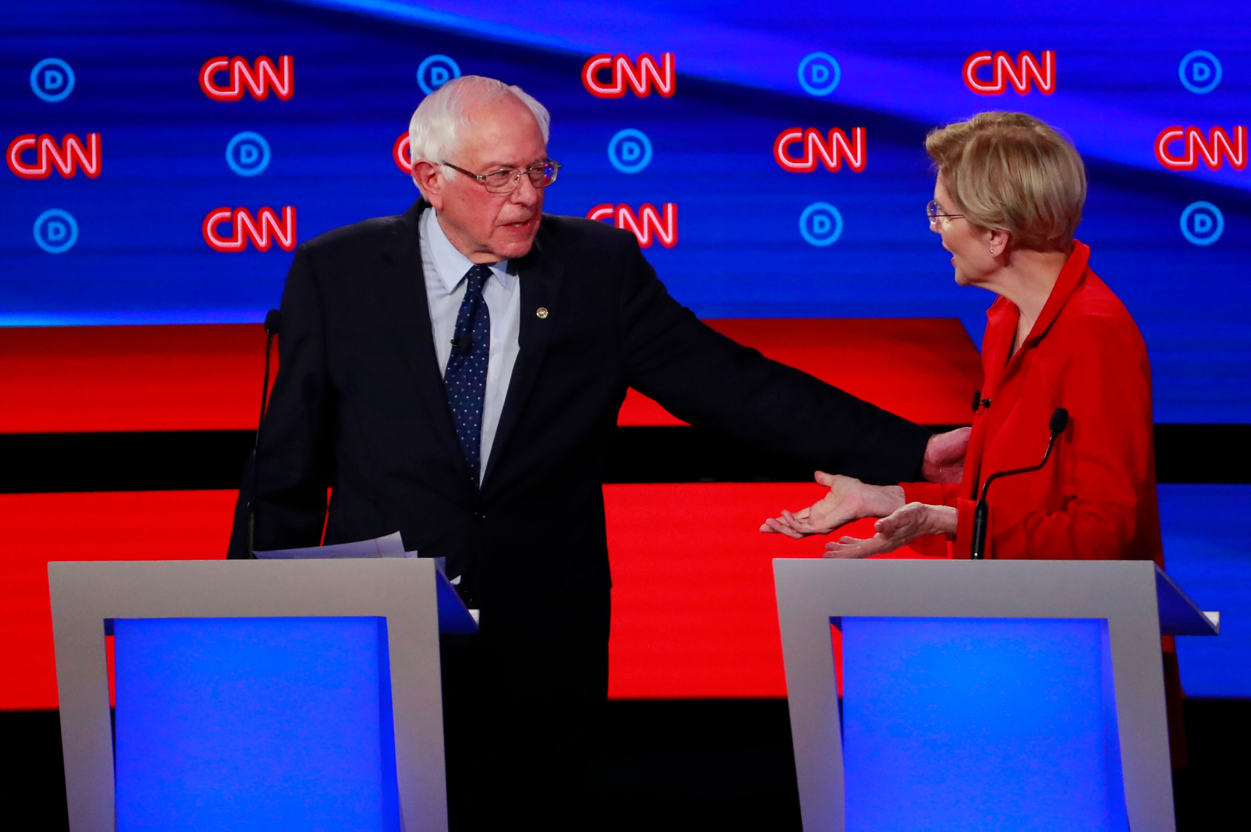 Bernie Sanders, left, greets Elizabeth Warren at the July 30 debate in Detroit, Michigan. The two candidates reportedly had a