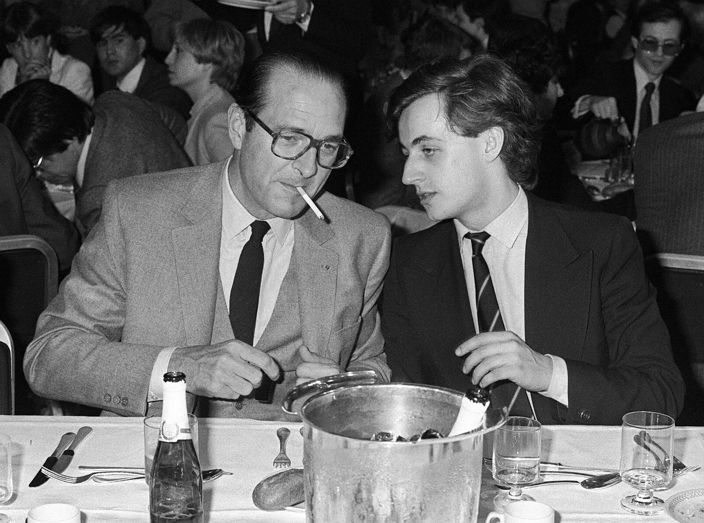 Paris Mayor Jacques Chirac, left, speaks with Nicolas Sarkozy, 26, on March 24, 1981. At the time, Chirac was president of th
