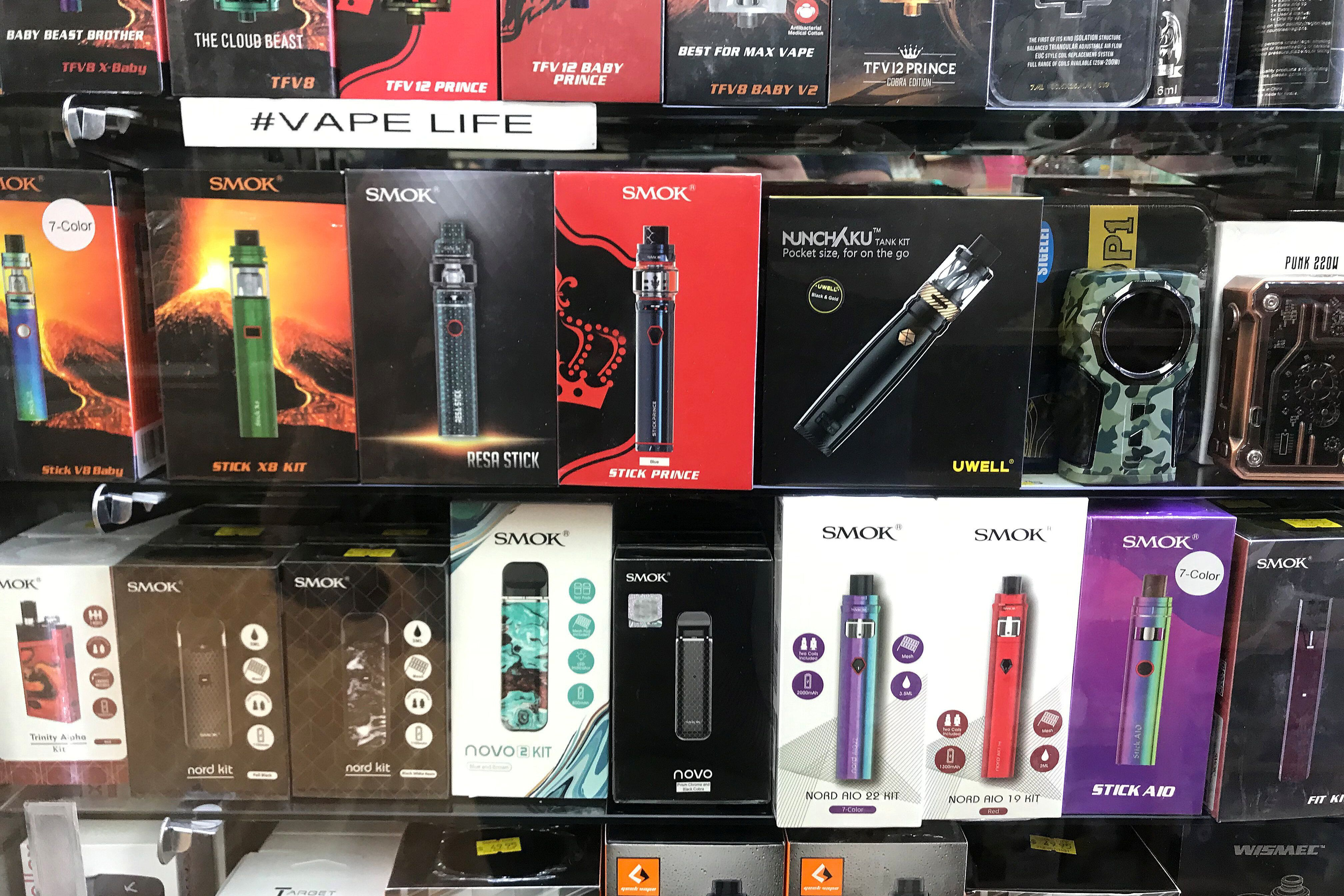 Vaping products on display in a store window in New York City.