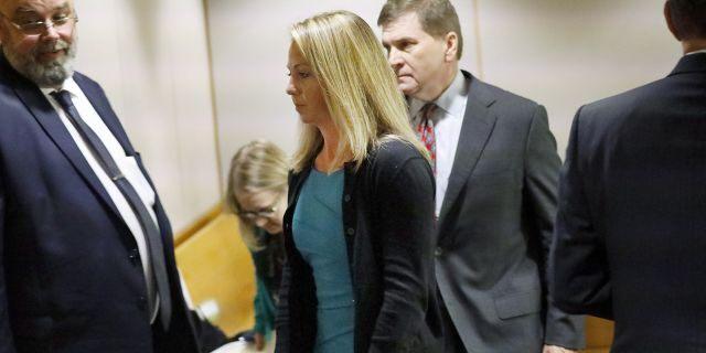 Amber Guyger leaves the courtroom Thursday. (Tom Fox/The Dallas Morning News via AP, Pool)