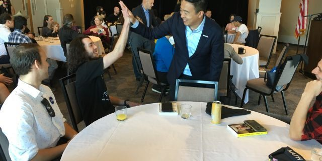 Democratic presidential candidate Andrew Yang greets audience members at a chamber of commerce event in Portsmouth, N.H., on Sept. 27, 2019