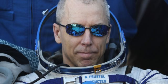 NASA astronaut Andrew Feustel rests in a chair shortly after landing in a remote area outside the town of Dzhezkazgan (Zhezkazgan), Kazakhstan, on Oct. 4, 2018.