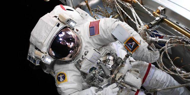 NASA astronaut Nick Hague sporting the Artemis logo during a spacewalk on Aug. 22. (NASA)