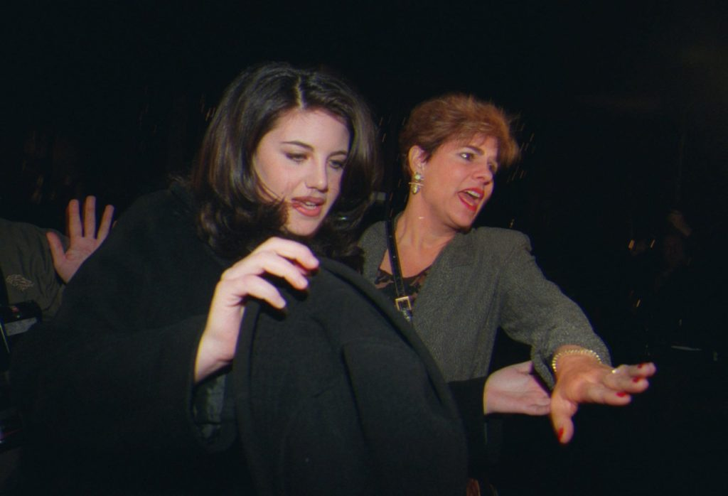 Monica Lewinsky and her stepmother, Barbara Lewinsky push through a large crowd of media as they leave a Santa Monica, Calif., restaurant Thursday Feb. 5, 1998. (AP Photo/Nick Ut)