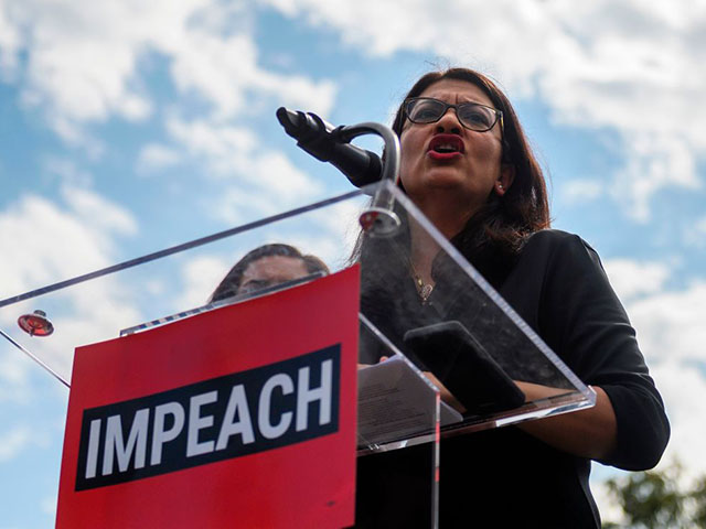 """Representative Rashida Tlaib (D-MI) speaks during the """"People's Rally for Impeachment"""" on Capitol Hill in Washington, DC on September 26, 2019. - Top US Democrat Nancy Pelosi announced on September 24 the opening of a formal impeachment inquiry into President Donald Trump, saying he betrayed his oath of office by seeking help from a foreign power to hurt his Democratic rival Joe Biden. (Photo by ANDREW CABALLERO-REYNOLDS / AFP) (Photo credit should read ANDREW CABALLERO-REYNOLDS/AFP/Getty Images)"""