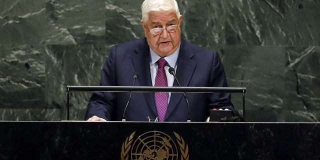 Syria's Foreign Minister Walid al-Moallem addresses the 74th session of the United Nations General Assembly, Saturday. (AP Photo/Richard Drew)
