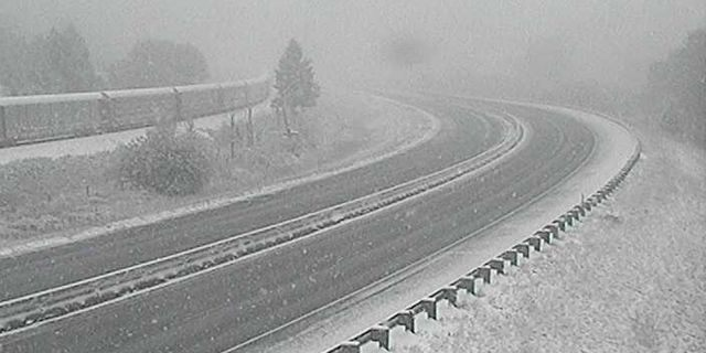 Wintry conditions were impacting Interstate 90 near Bearmouth, Mont. on Sunday.