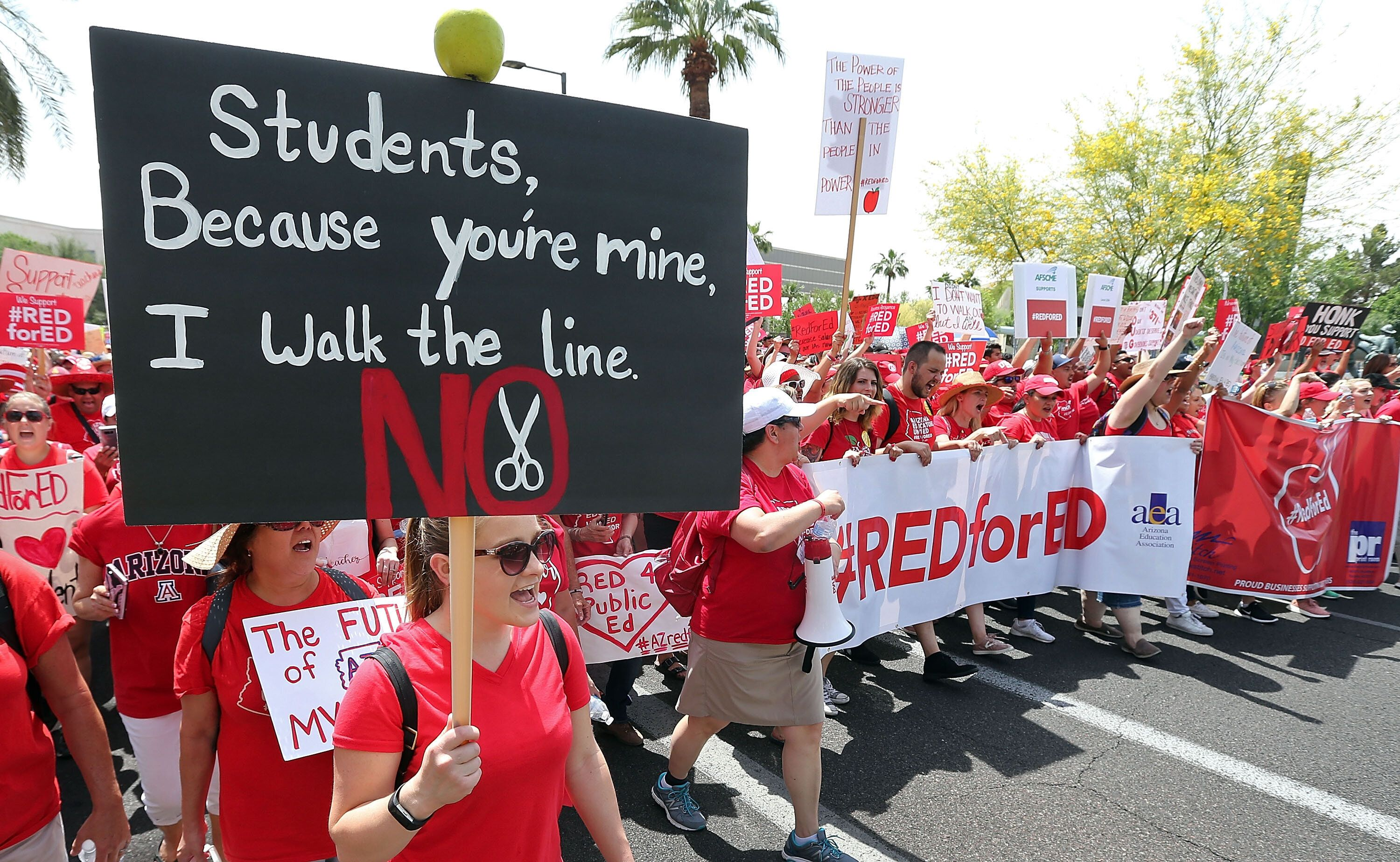Arizona teachers march through downtown Phoenix on their way to the State Capitol as part of a rally for the #REDforED moveme