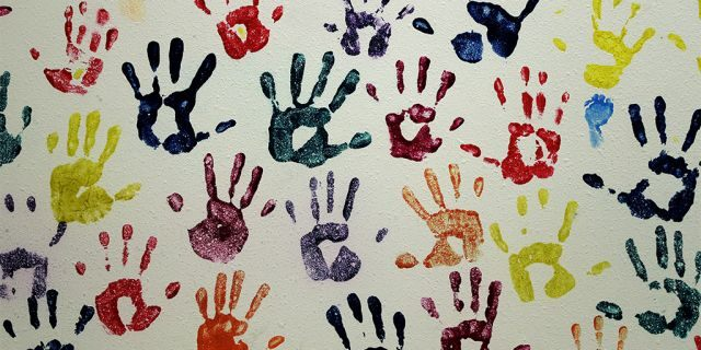 """Handprints representing migrant children line a hall at a """"tender-age"""" facility for babies, in Texas' Rio Grande Valley, Thursday, Aug. 29 in San Benito, Texas. Sheltering migrant children has become a booming business for Comprehensive Health Services, a Florida-based government contractor, as the number of children in government custody has swollen to record levels over the past two years. (AP Photo/Eric Gay)"""