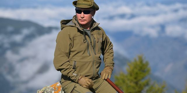 Putin rests on a hill in Siberia during a break from state affairs ahead of his birthday. (Alexei Druzhinin, Sputnik, Kremlin Pool Photo via AP)
