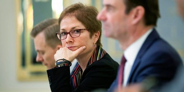 Former U.S. Ambassador to Ukraine Marie Yovanovitch, center, is set to testify on Friday on Capitol Hill. (Mikhail Palinchak, Presidential Press Service Pool Photo via AP)