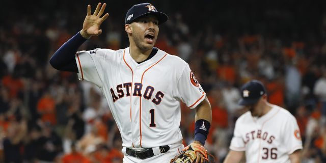 Houston Astros shortstop Carlos Correa celebrates after the end of the top of the sixth inning in Game 6 of baseball's American League Championship Series against the New York Yankees, Oct. 19, 2019, in Houston. (Associated Press)