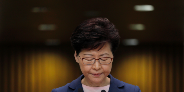 In this Tuesday, July 9, 2019, file photo, Hong Kong Chief Executive Carrie Lam pauses during a press conference in Hong Kong. (AP Photo/Vincent Yu, File)