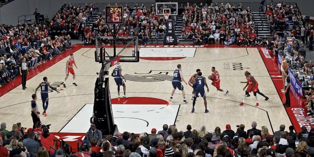The Portland Trail Blazers, in red uniforms, play an NBA preseason game against the Denver Nuggets at Memorial Coliseum in Portland, Ore., Tuesday, Oct. 8, 2019. (Associated Press)