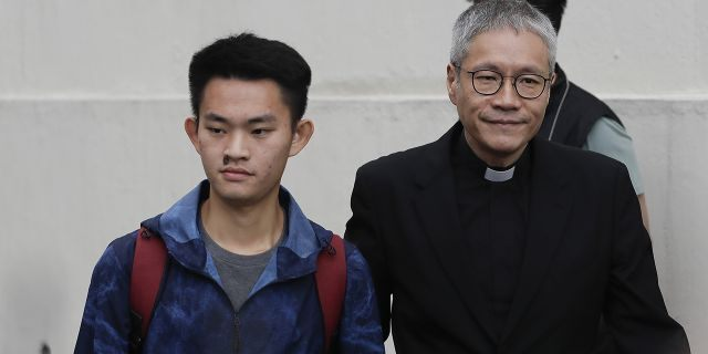 Chan Tong-kai, left, walks out as he is released from prison in Hong Kong Wednesday, Oct. 23, 2019.