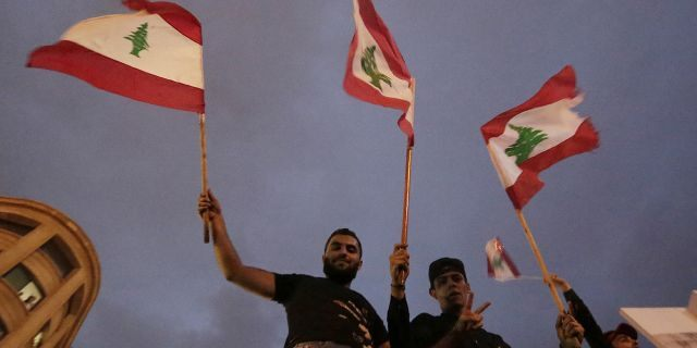 """Lebanon's President Michel Aoun has told tens of thousands of protesters that an economic reform package put forth by the country's prime minister will be the """"first step"""" toward saving Lebanon from economic collapse. (AP Photo/Hassan Ammar)"""