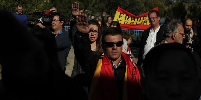 People make the fascist salute as they gather outside Mingorrubio's cemetery, outskirts of Madrid, Thursday.