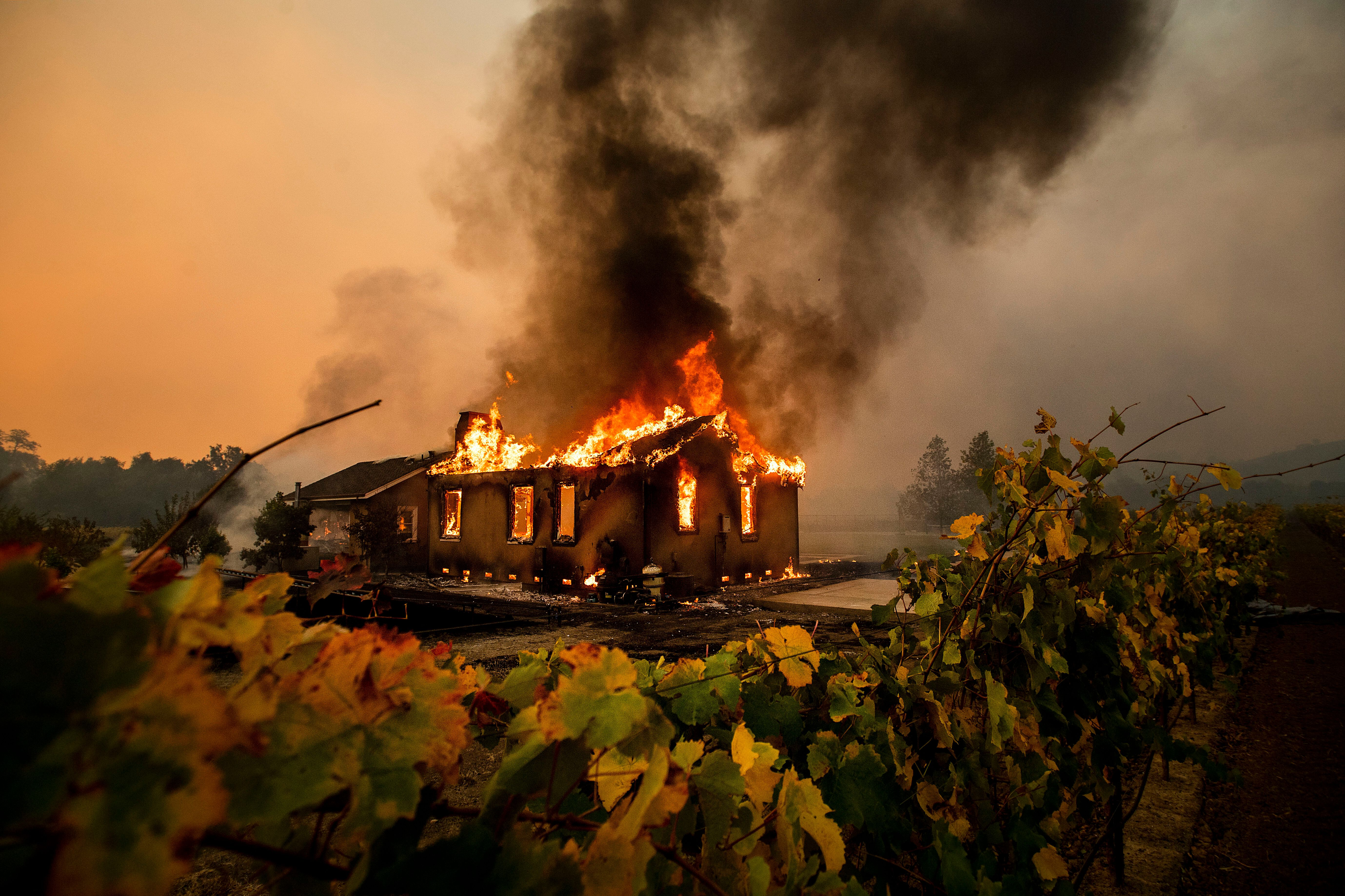 The Kincade fire burns through the Jimtown community of unincorporated Sonoma County on Oct. 24, 2019.