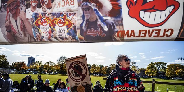 """Protesters, including Marcy Hart of the White Earth Nation, march from Peavey Park to US Bank Stadium to protest the use of """"Redskins"""" in the name of the Washington NFL football team, before Washington's game against the Minnesota Vikings on Thursday, Oct. 24, 2019, in Minneapolis. Protesters also had signs about the Kansas City Chiefs, the Cleveland Indians and the Atlanta Braves."""