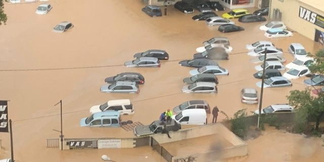 This Oct. 23, 2019 image made by Twitter user @SDIS34 shows cars flooded in the southern France. France's Interior ministry says three people have been killed in torrential rains that flooded towns and villages in southern France this week.