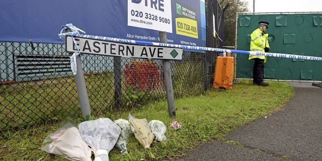 Floral tributes at the Waterglade Industrial Park in Thurrock, Essex, England Thursday Oct. 24, 2019 the day after 39 bodies were found inside a truck on the industrial estate.