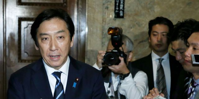 Japan's Trade Minister Isshu Sugawara speaks to the media at the parliament in Tokyo on Oct. 25, 2019.