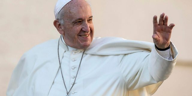 Pope Francis waves during his weekly general audience in St. Peter's Square at the Vatican, Wednesday, Oct. 9, 2019. (Fabio Frustcai/ANSA via AP)