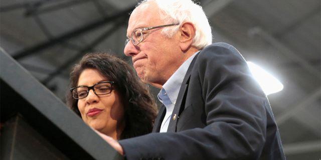 Democratic 2020 U.S. presidential candidate Senator Bernie Sanders and Rep. Rashida Tlaib address the audience during a Sanders campaign rally in Detroit, Michigan. (REUTERS/Rebecca Cook)