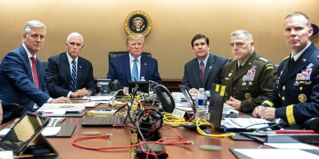 In this photo provided by the White House, President Donald Trump is joined by from left, national security adviser Robert O'Brien, Vice President Mike Pence, Defense Secretary mark Esper, Joint Chiefs Chairman Gen. Mark Milley and Brig. Gen. Marcus Evans, Deputy Director for Special Operations on the Joint Staff, Saturday, Oct. 26, 2019, in the Situation Room of the White House. (Shealah Craighead/The White House via AP)